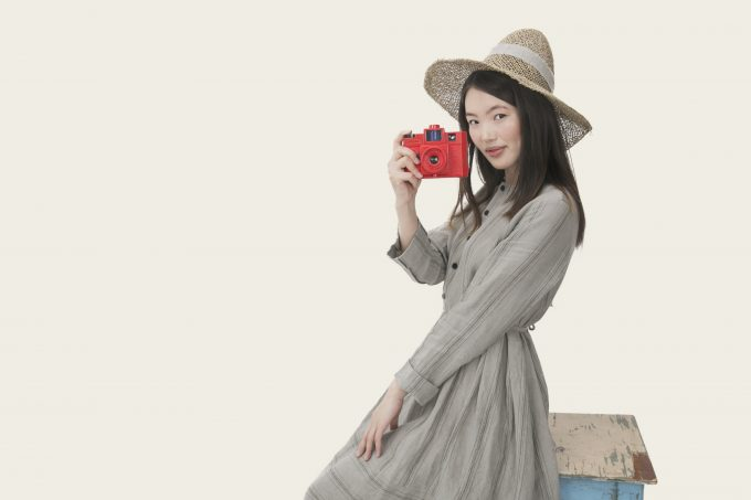 Asian girl with a red photocamera