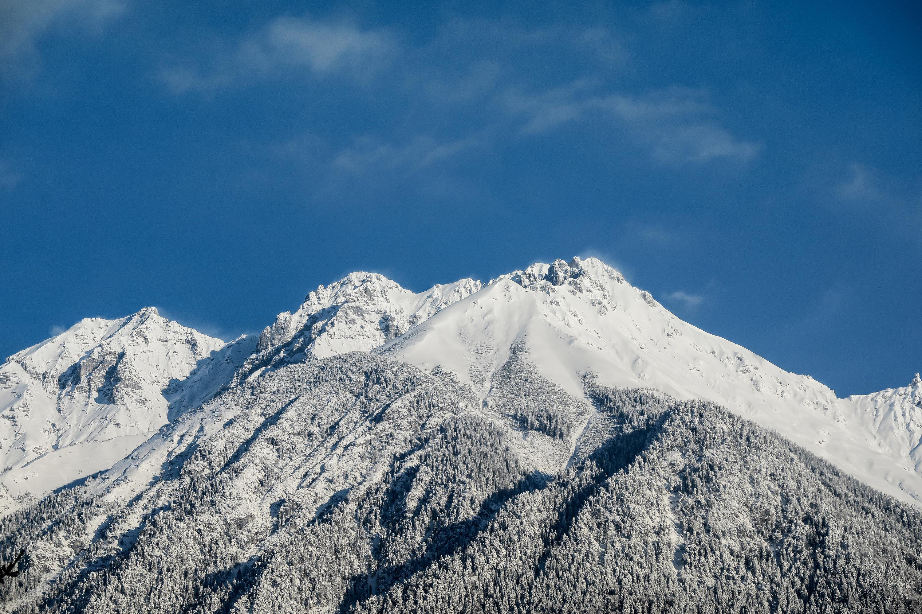 The majestic Austrian Alps covered with fresh snow in March.