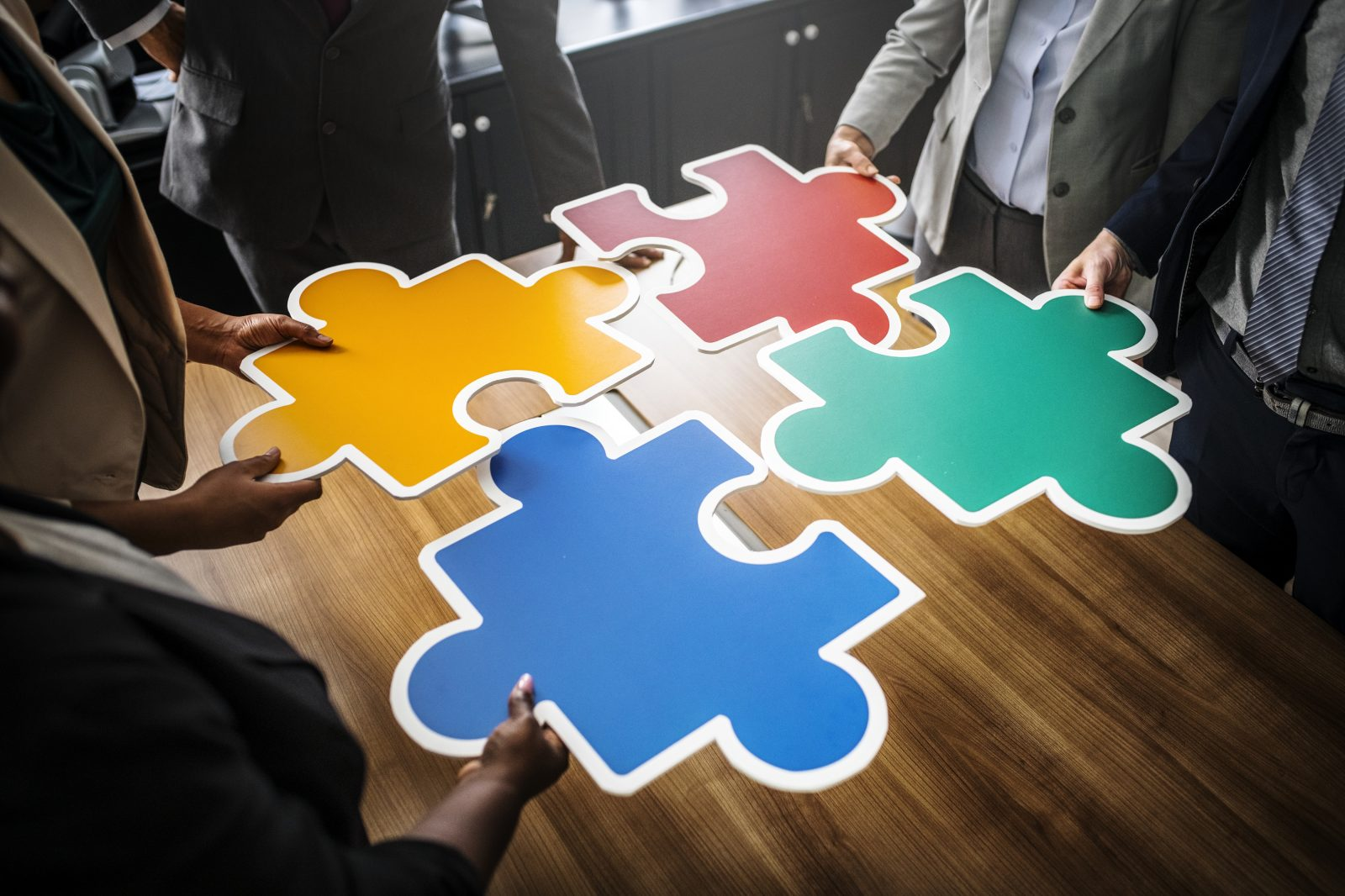 business people connecting puzzle pieces free stock photos life