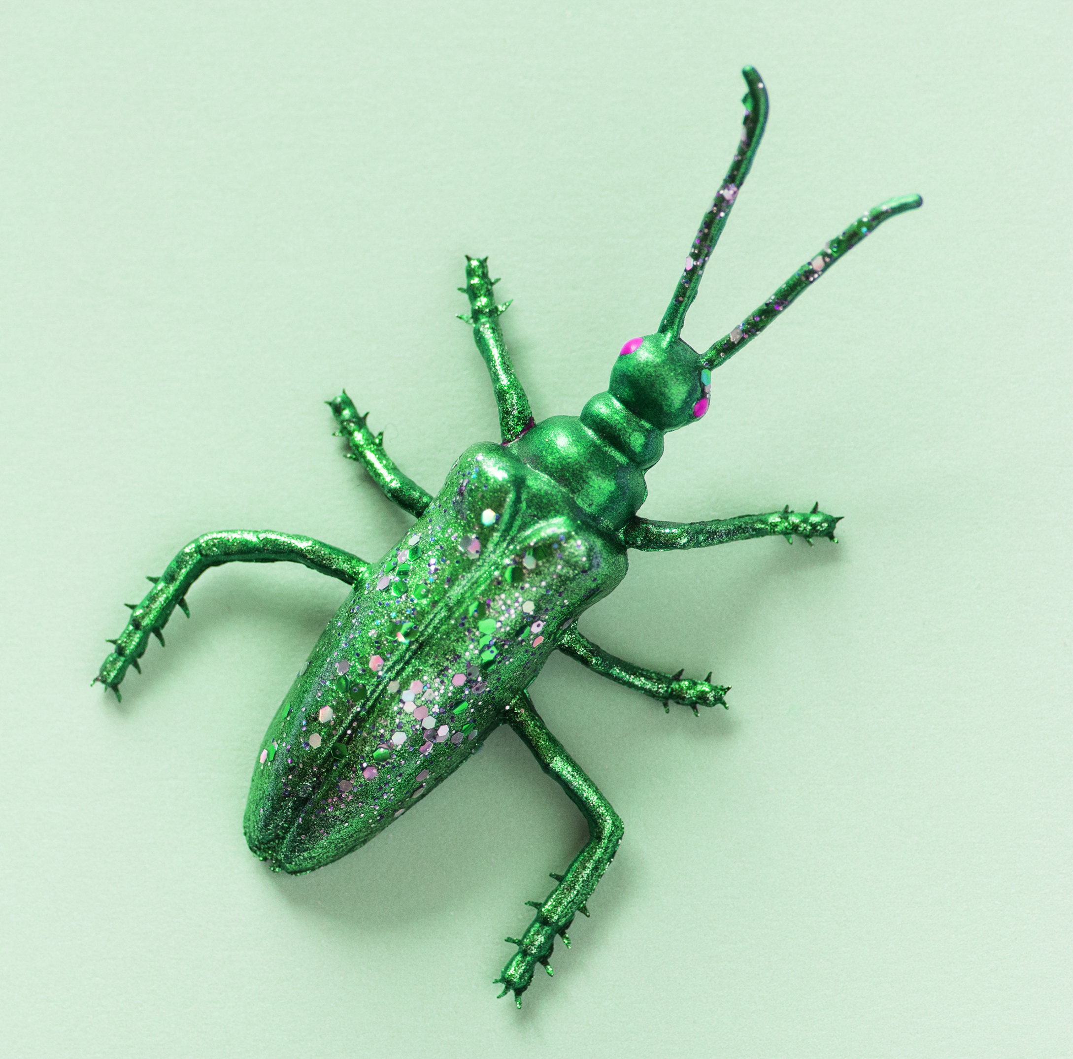Colorful miniature bug on a paper