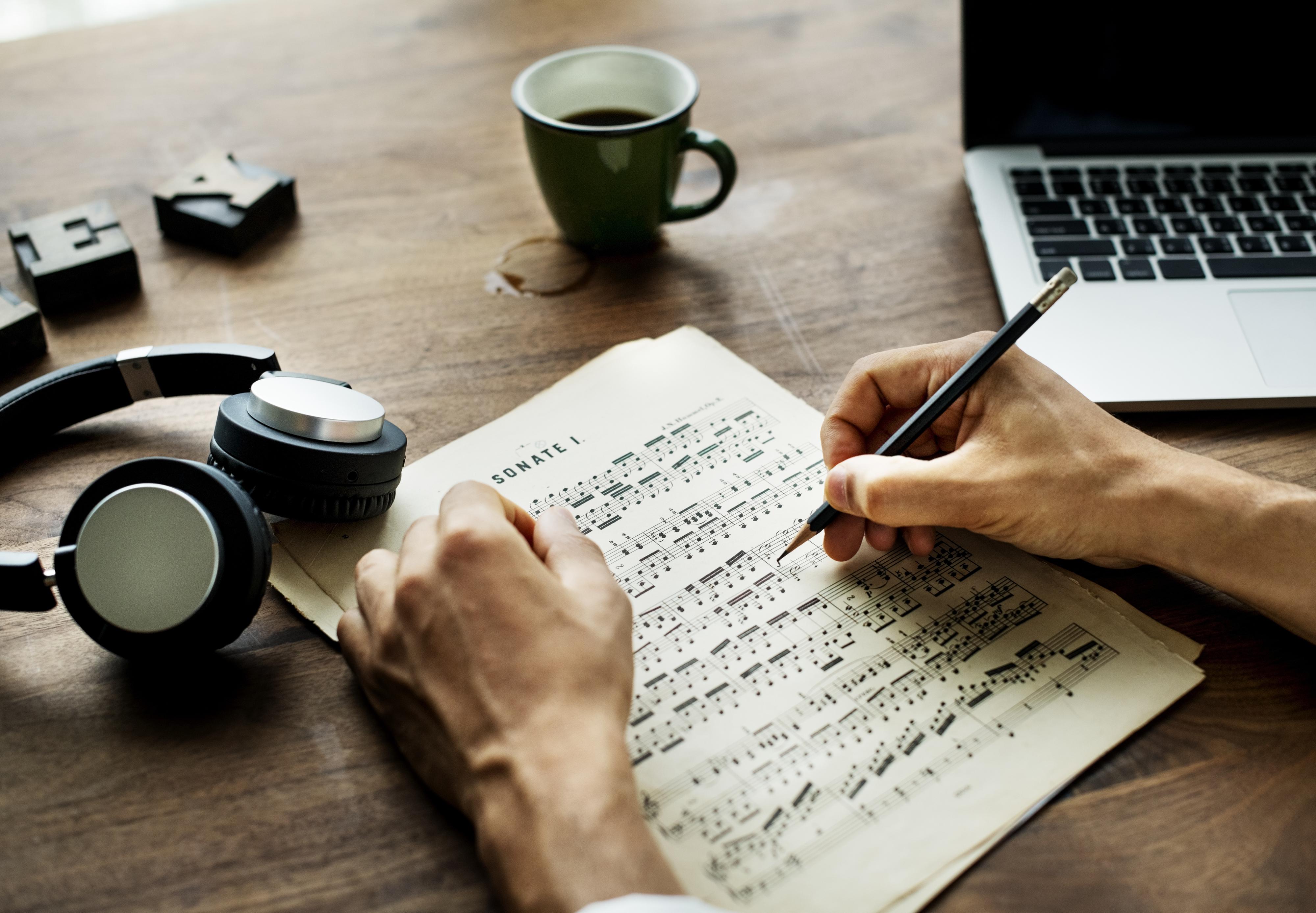 Closeup on casual man composing music