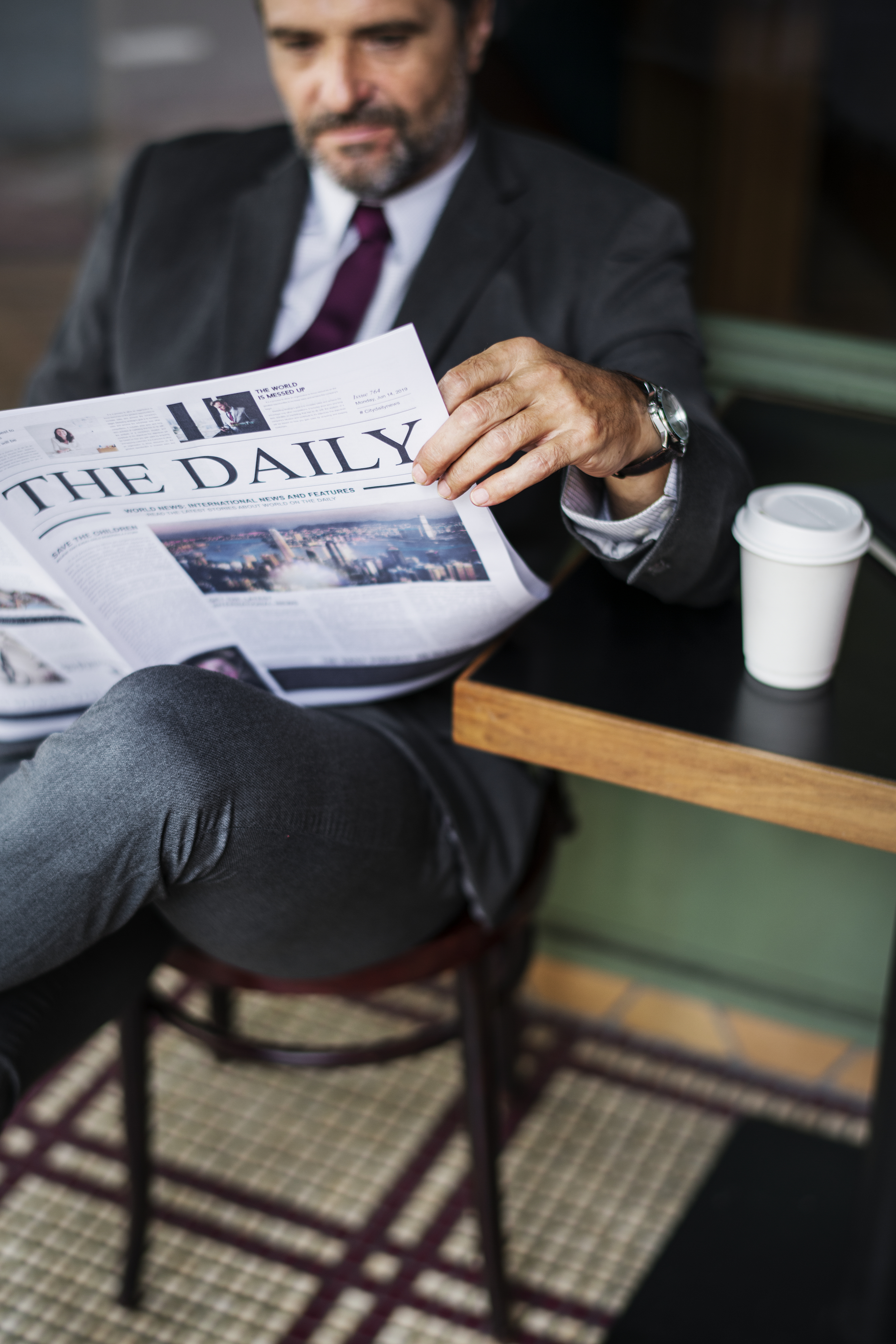 Businessman reading the daily news